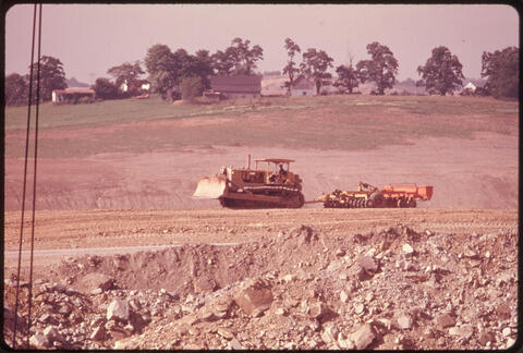 Erik Calonius - Bulldozer Pulling A Seeding Machine over Recontoured Land That Had Previously Been Strip Mined by the Coal Companies Off Route $800 near Edgewater Park, Ohio, and Barnesville, 1974