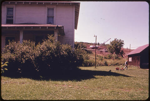 Erik Calonius - Many People in Southeastern Ohio Are Never Far Away from the Sight of Strip Mining. The Resident of This Farmhouse Off Route #800, 1974