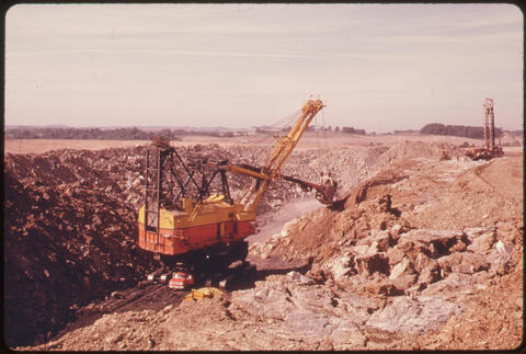 Erik Calonius - One of the Coal Company Power Shovels Digs for the Solid Fuel at the Left. At the Right a Machine Is Probing the Location of the Coal Seam Off Route #800, 1974