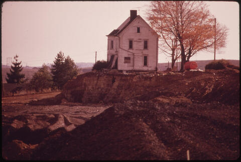 Erik Calonius - This House Off Route 250, Has Had Its Windows and Doors Knocked Out, Legally Qualifying It as Derelict. Now the Coal Company Is Stripping Around It 1973