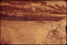 Erik Calonius - Farmland Stripped by the Hanna Coal Company Off Route 100 near Morristown, Ohio, and Steubenville. A Dammed Stream Has Flooded Part of the Area, in Apparent Violation of State Law 1973